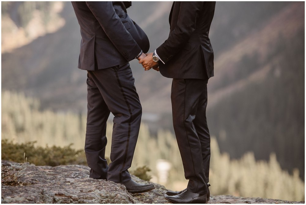 Brian and Ernie take hands as they pledge their lives to each other in their own, private elopement ceremony, a beautiful detail they included in their small simple wedding.