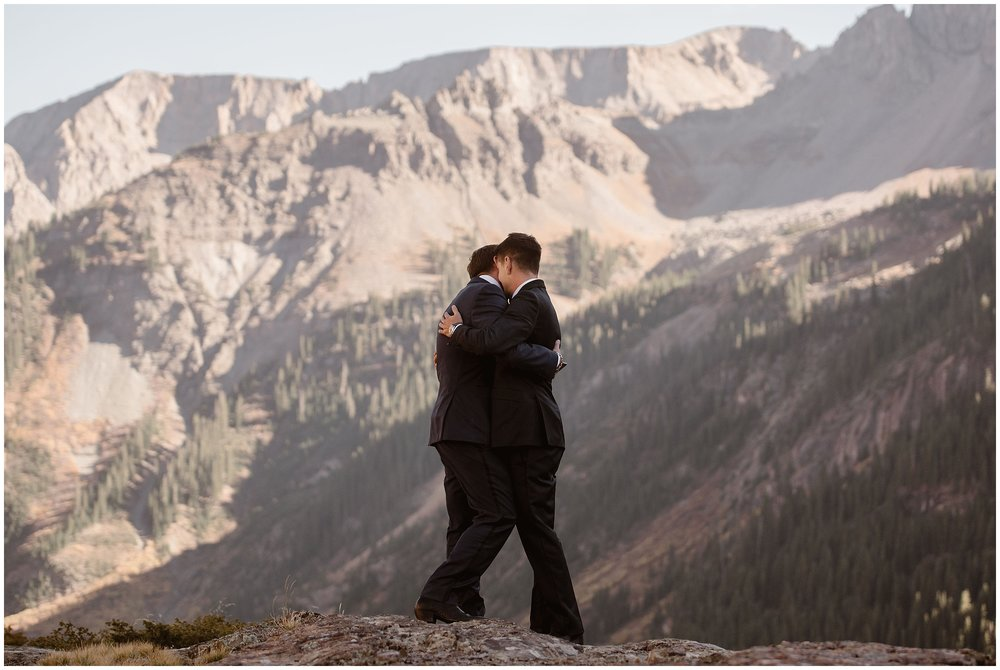 Brian and Ernie embrace as they finish reading their private vows during their intimate elopement ceremony. As soon as this private ceremony is over, they'll continue on with an elopement ceremony that's more focused on eloping with family members.