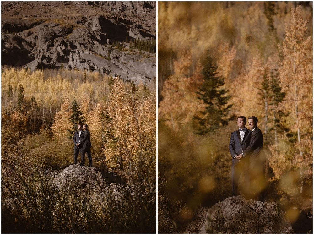 Brian and Ernie, the two groom, stand on a jagged, rocky platform among vibrant and vivid golden aspen trees in these side-by-side elopement photos. They hold hands as they look out over the gorgeous location where they just had their elopement ceremony.