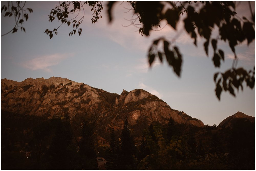 A gorgeous alpenglow sets on the San Juan mountain range in Ouray, Colorado, the location where Brian and Ernie chose to have their 4x4 elopement and their small simple wedding ceremony.