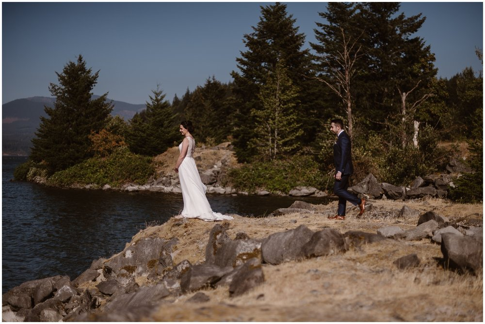 David sneaks up on Lauryn, his soon-to-be-wife. She faces away from him, toward the Columbia River Gorge, as he walks up behind her for their first look before their elopement ceremony.