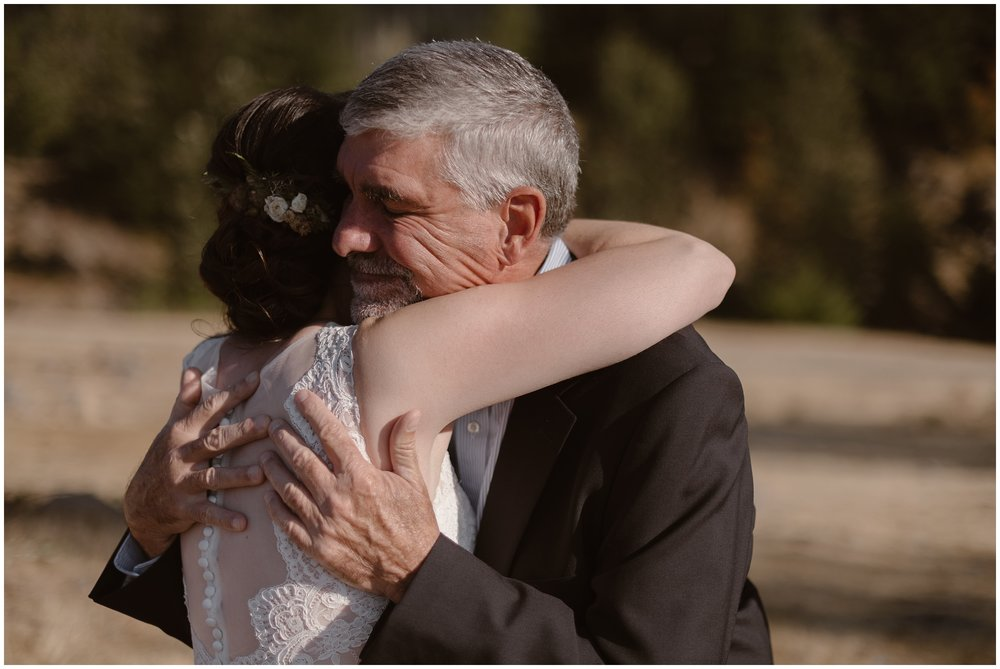 Lauryn and her dad have a close, intimate moment as they hug before the Columbia River Gorge elopement ceremony begins .