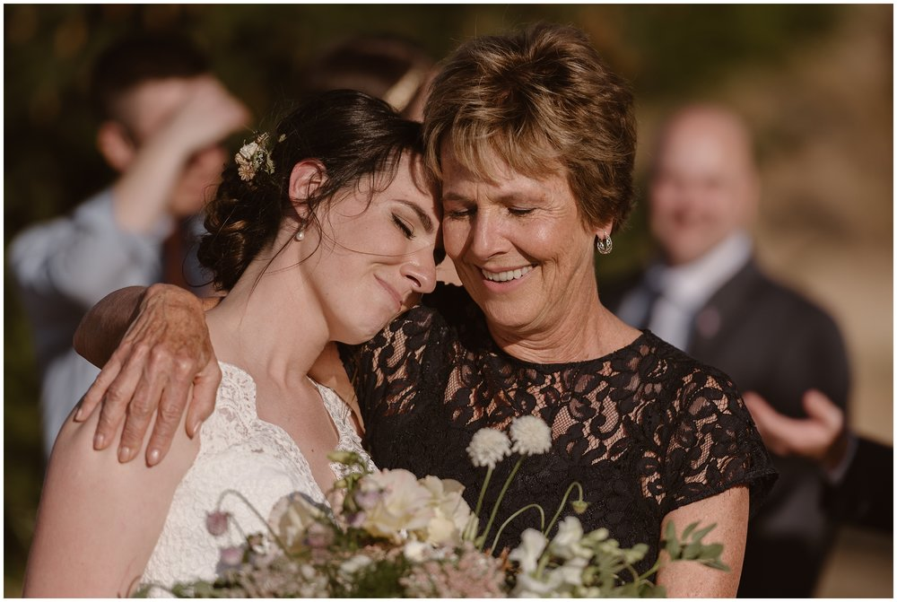 Lauryn leans in close to embrace her mother, resting her head on her shoulder and shutting her eyes. Including family was one of the unique eloping ideas that the bride and groom wanted for their small simple wedding on the Columbia River Gorge.