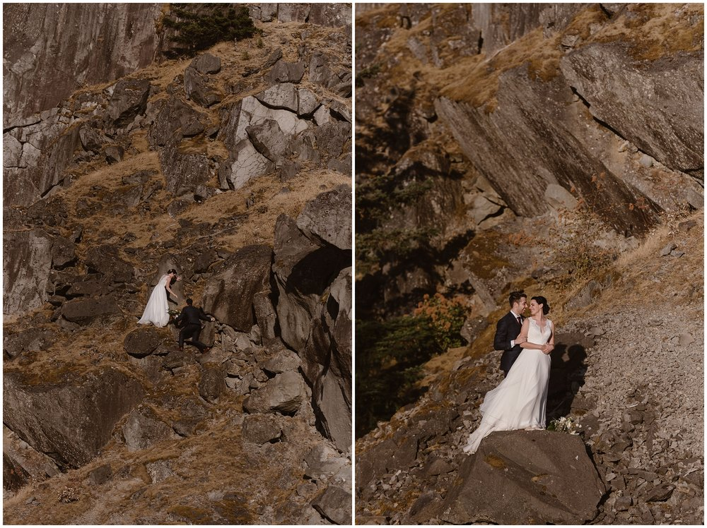 Still in their wedding clothes, Lauryn and David adventurously scale a large, vertical rock to explore after their elopement ceremony. Lauryn and David chose to get married in the Columbia River Gorge for their first elopement day so they could include their family.