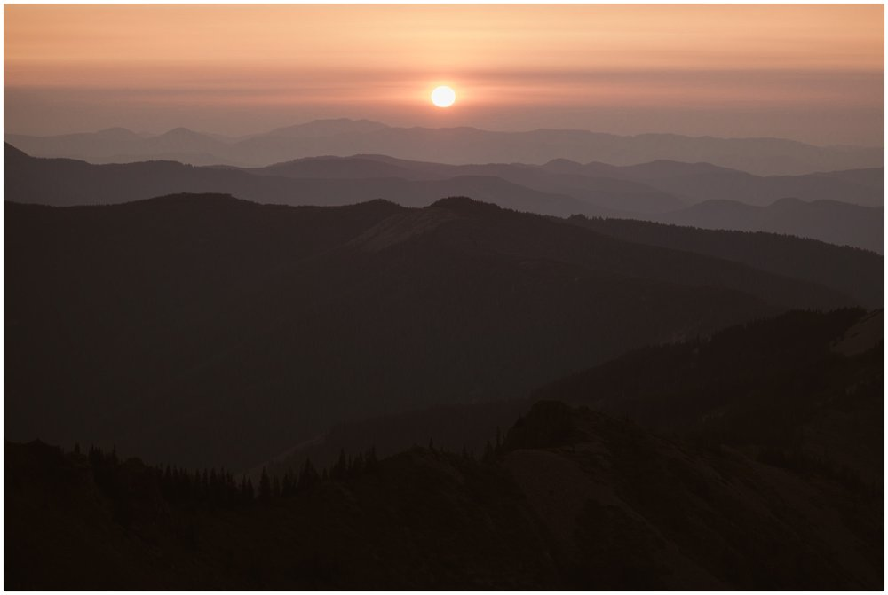 The sun slowly rises over the mountain ranges, giving off a hazy, pink color. Both Lauryn and David and wanted to elope in Washington state in hopes of catching this beautiful view at sunrise.