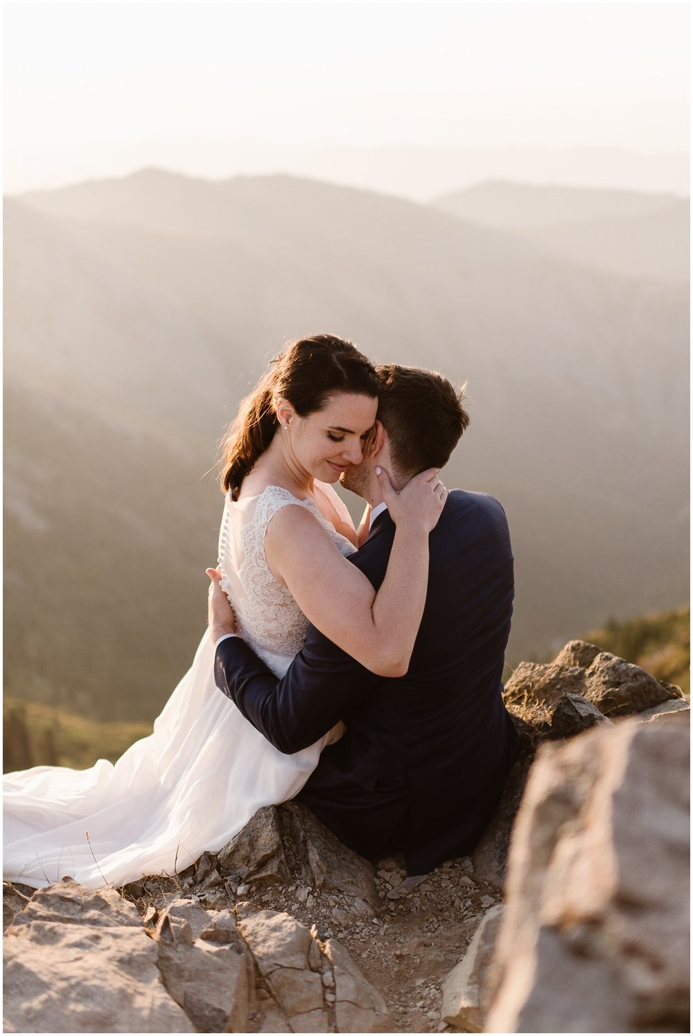 Lauryn and David hold each other close in an embrace during the beautiful, sunrise moments at the top of the mountain in Washington. When they were planning on how to elope in Washington State, they knew they wanted to include a sunrise hike for this reason.