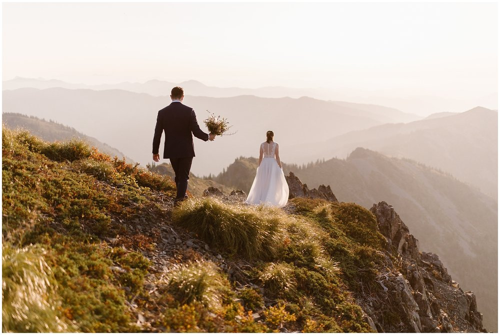 David follows Lauryn further onto the trail as they continue forward to elope in Washington state on the top of the mountain.