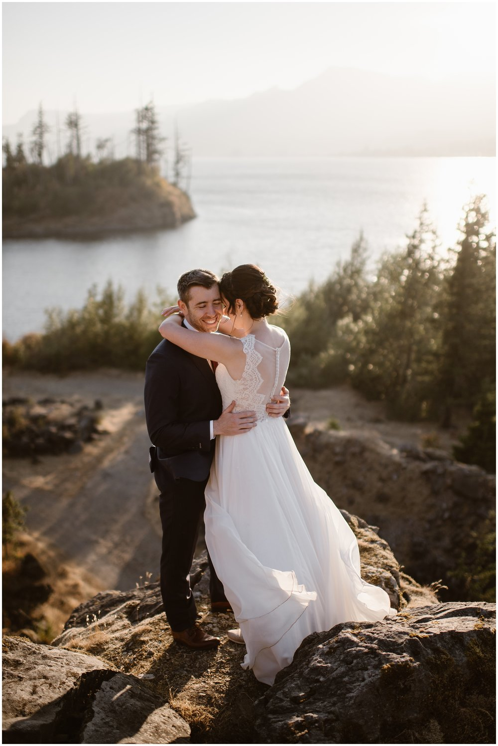 In these elopement pictures captured by Oregon elopement photographer Adventure Instead, Lauryn and David hold each other close and kiss as golden light streams in on them. In the background, PNW islands dot the Columbia River.