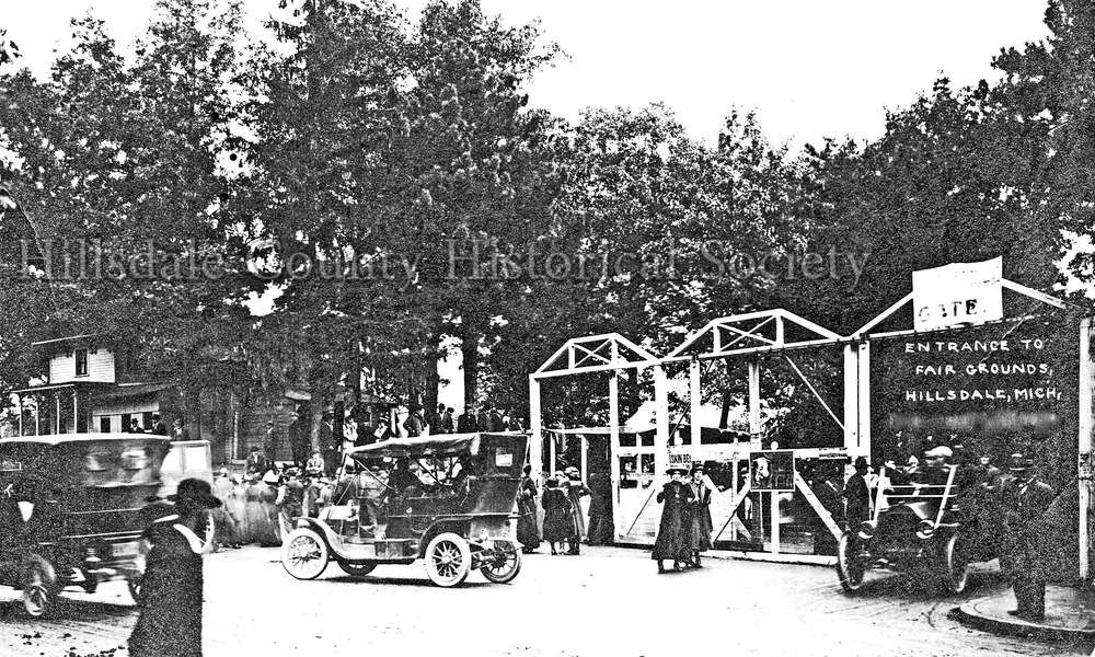 "The Entrance to the fair in the early 1900s is still used today ... without the wooden archways. The fair office was originally on the hill to the left rear of the picture. it's now the hillsdale county historical society museum. As early as 1879 the hillsdale college herald was lauding : … the success of our county fairs."" particularly interesting to the college crowd was the collection of artwork displayed by arious college professors."