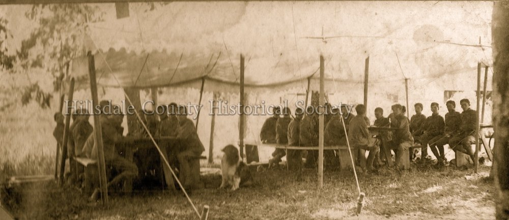 Michigan skirmishers mess tent at clear lake, IN encampment. cooks: Joe stone & charles busch - 1906