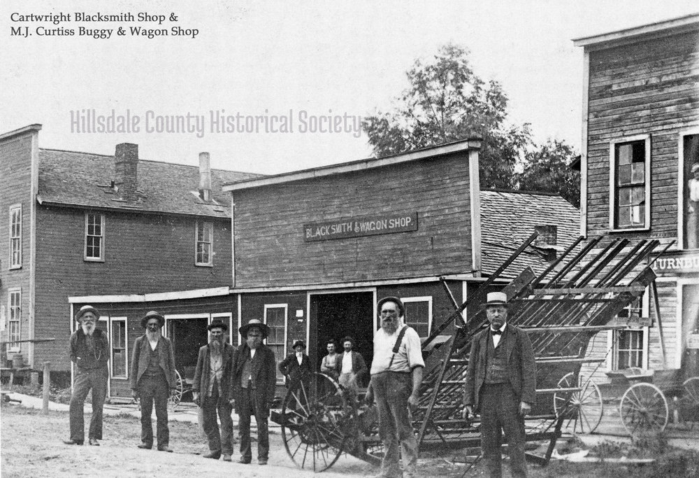 The Cartwright Blacksmith Shop and M.J. Curtiss Buggy & Wagon Shop