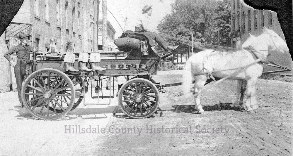 this early pumper was operated by two men pushing on the bars to draw water.