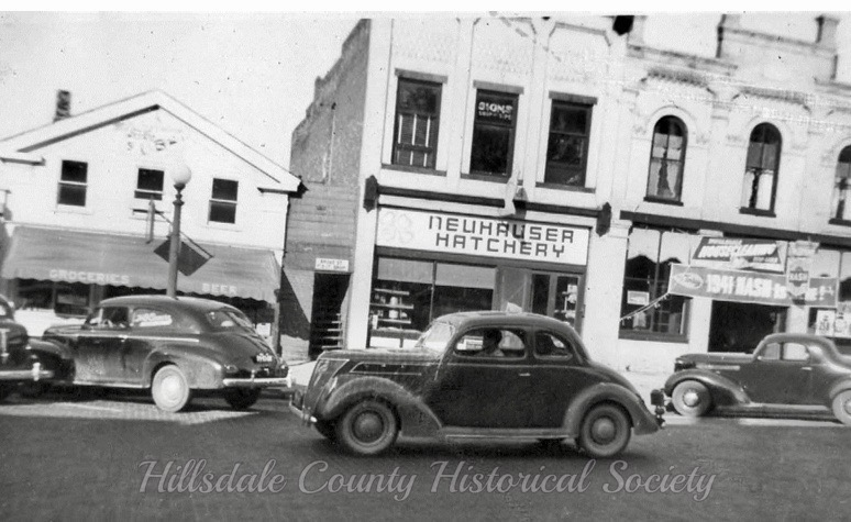 Ken fox, ging north on broad street, just north of mccollum, past binder motor sales on the corner (advertising the 1941 nash), the neuhauser hatchery and the silliven grocery, which is today a parking lot.