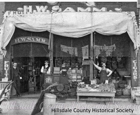 the early days of the H,W, samm store on howell street, with Ord Letherer, George perry and hubert samm. the samm building remained in the same family for approximately 100 years,