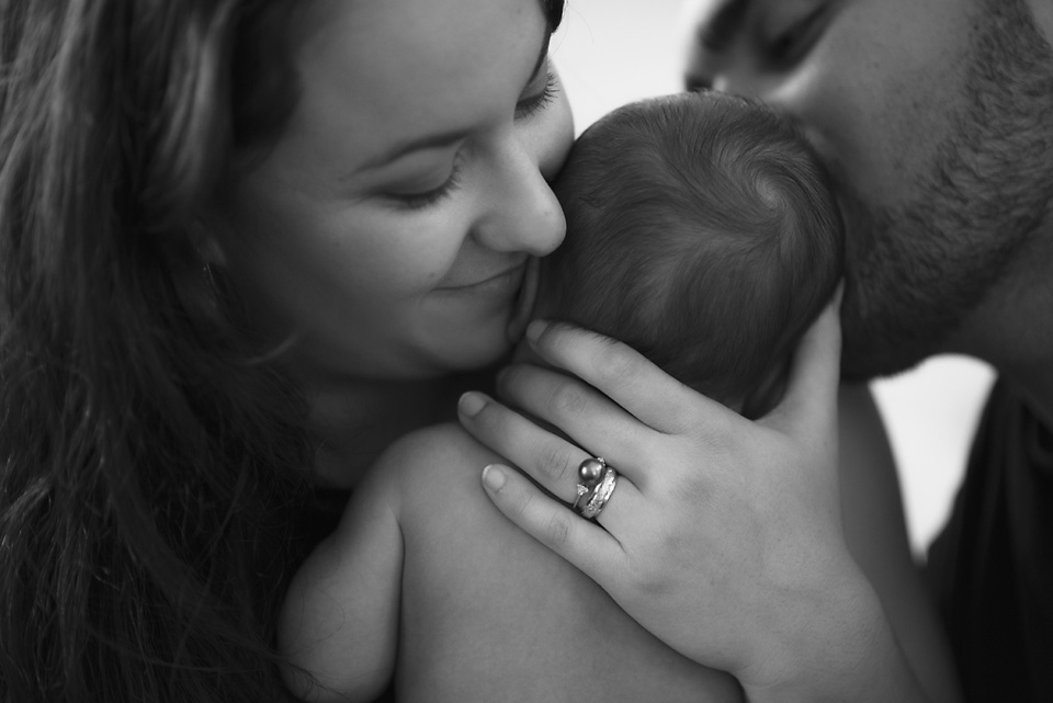 I love the tenderness in both parents. Even with a limited view, his fathers love is clear.
