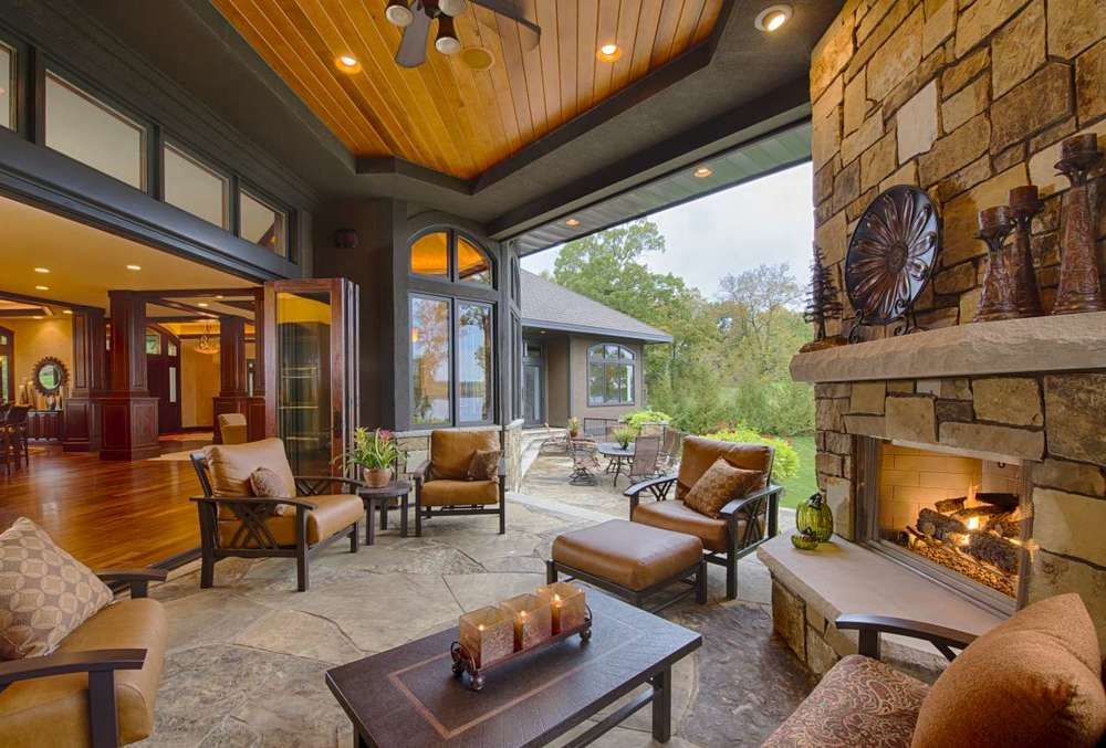 Outdoor living space with sliding screen doors and fireplace