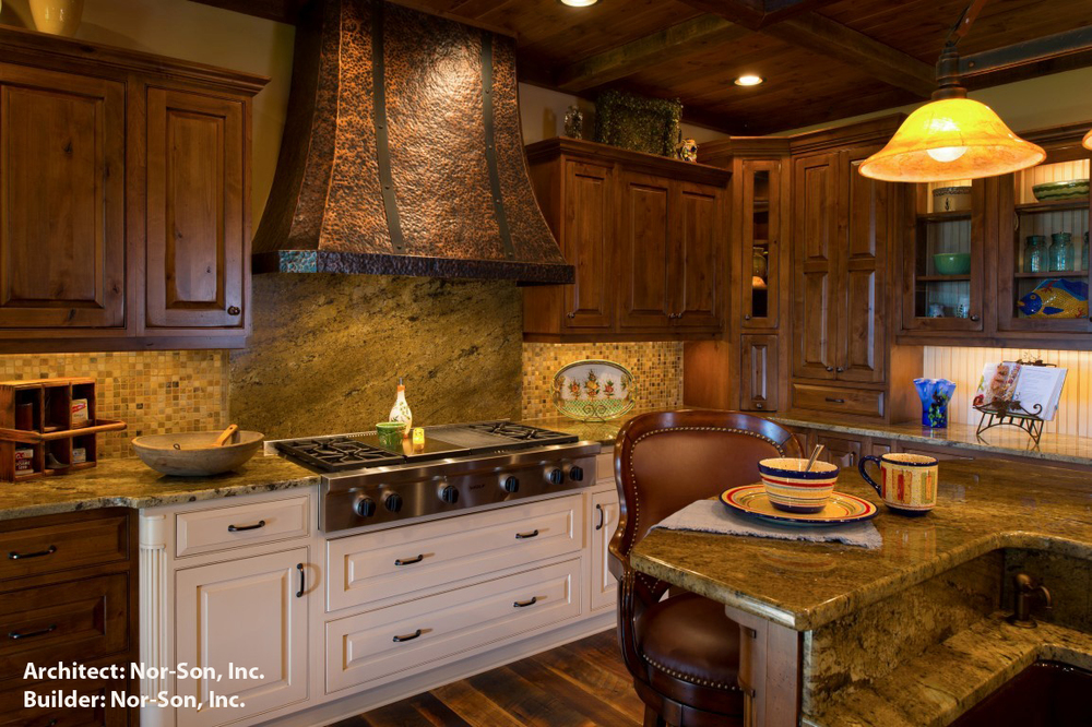 Rustic kitchen with marble backsplash by Nor-Son