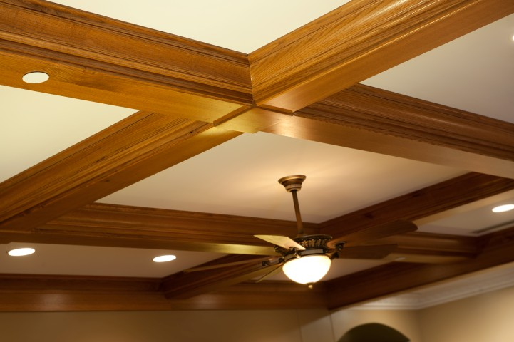 Wooden crossbeam ceiling with ceiling fan
