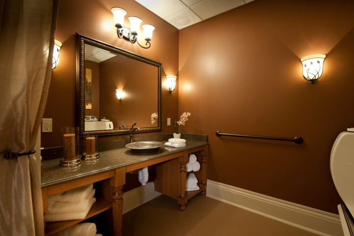 Restroom with large mirror and sink