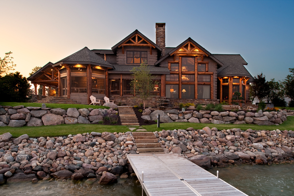 Luxury lake home exterior with stairs descending to water