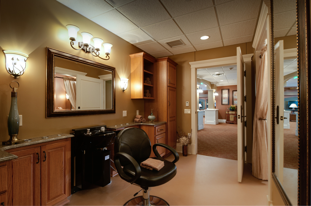 Senior living facility haircare with barber chair