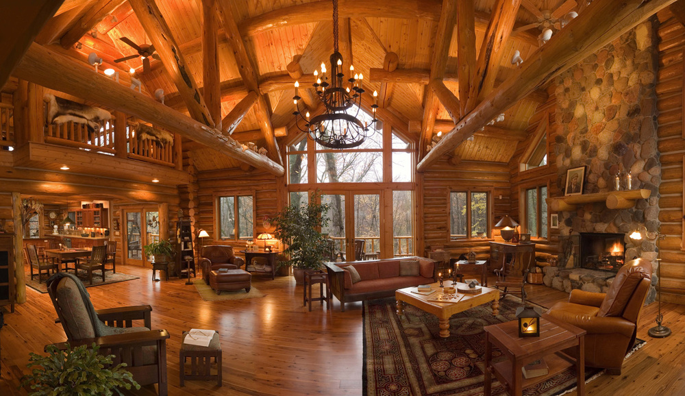 Luxury cabin living room with large windows, high ceilings and fireplace
