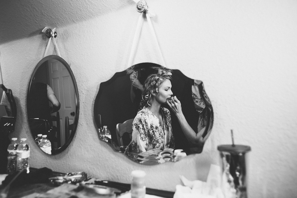 Bride in mirror Vista West Ranch | Lisa Woods Photography