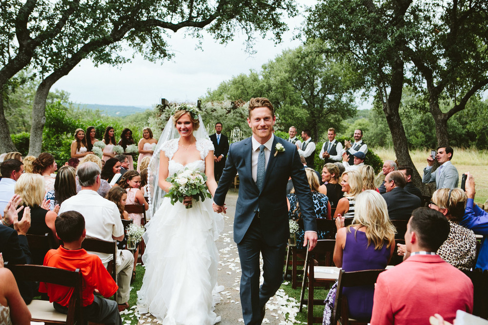 Bride and Groom Walking Down Aisle | Lisa Woods Photography