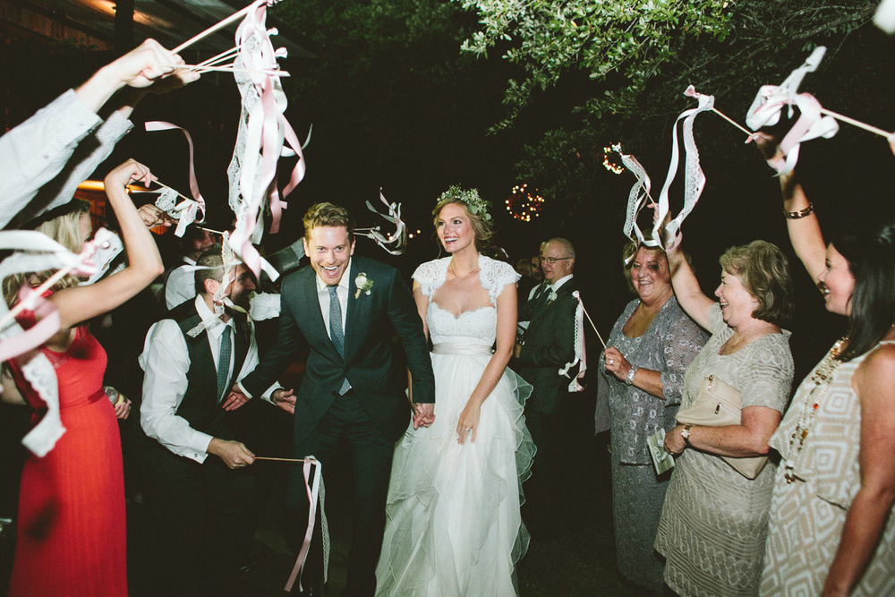 Streamer Grand Exit with Bride and Groom | Lisa Woods Photography