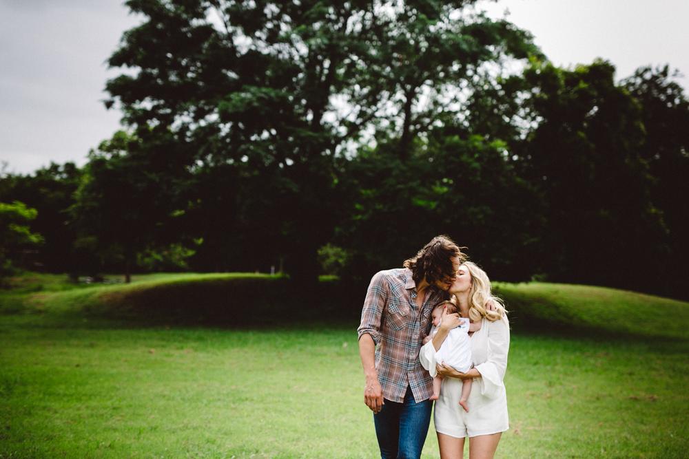 walking and kissing family photo