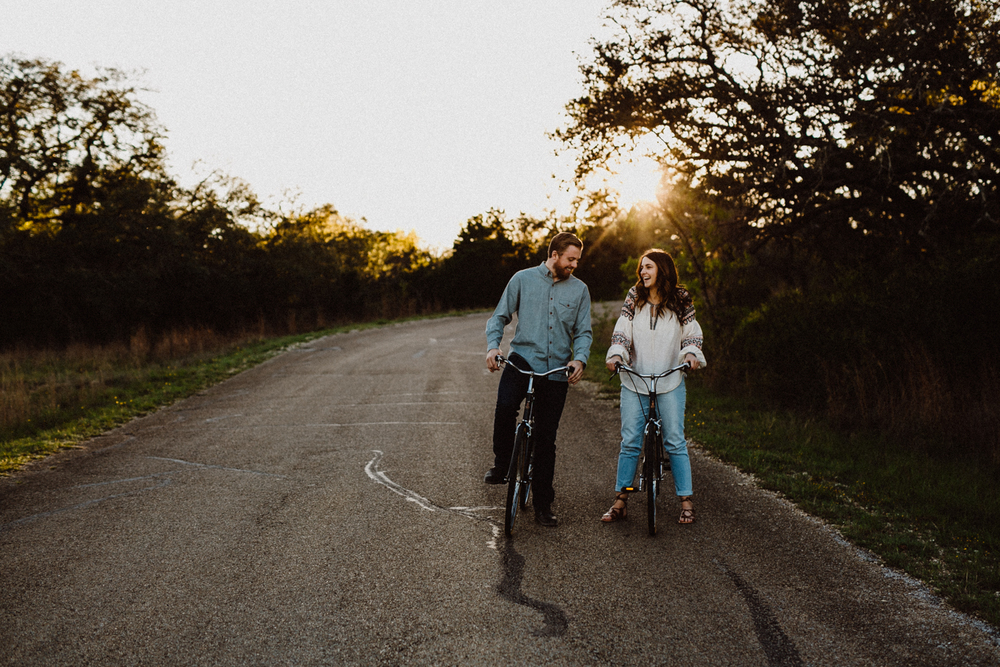 engaged couple on bikes