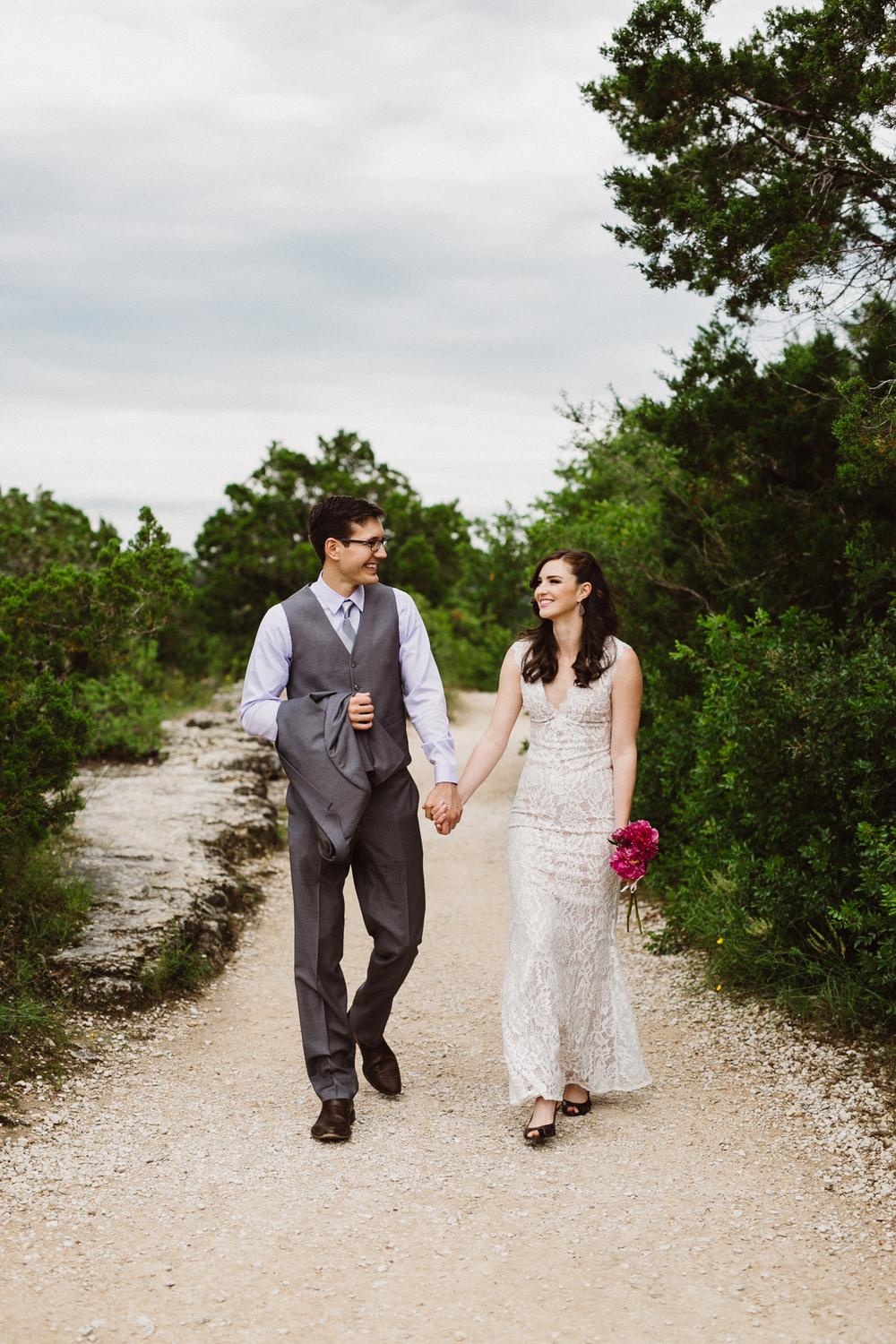 bride and groom at mt. bonnell