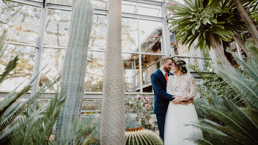 bride and groom in the greenhouse at driftwood