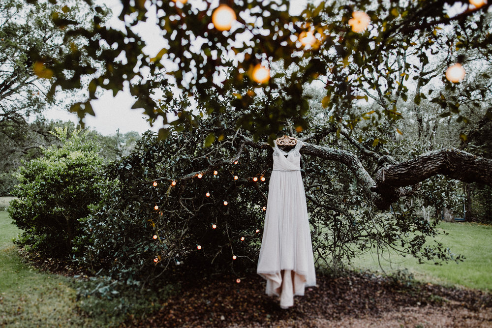 dress hanging from tree at wildflower barn