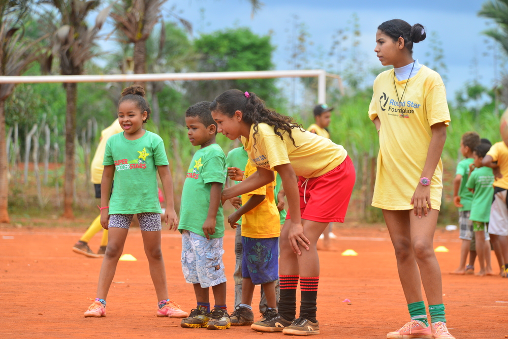 2 local adolescents practice coaching in Brazil in 2013