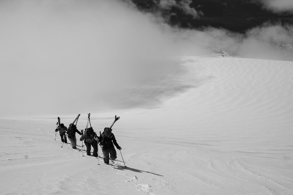 A group of friends climbing the final pitch of the first volcano they ever summited.