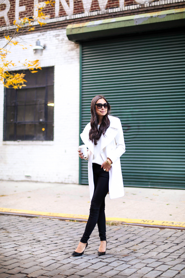 This post is from her Black + White post.  That white coat is absolutely stunning!  And I love how she kept the focus on the coat by wearing simple black skinny jeans, pumps, and a simple white shirt.  This outfit is the definition of effortlessly elegant!