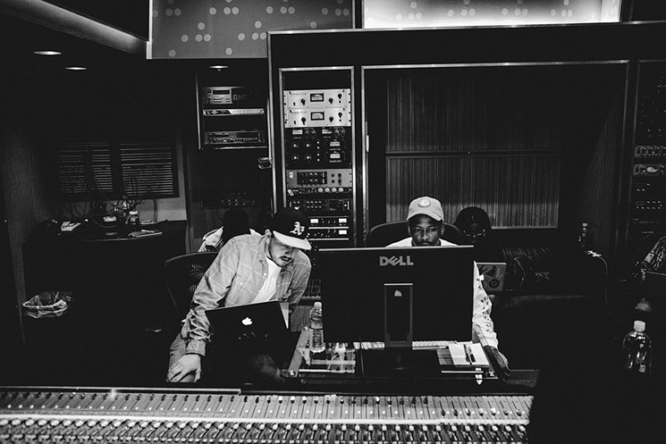 YG works on Still Brazy in Snoop Dogg's studio.