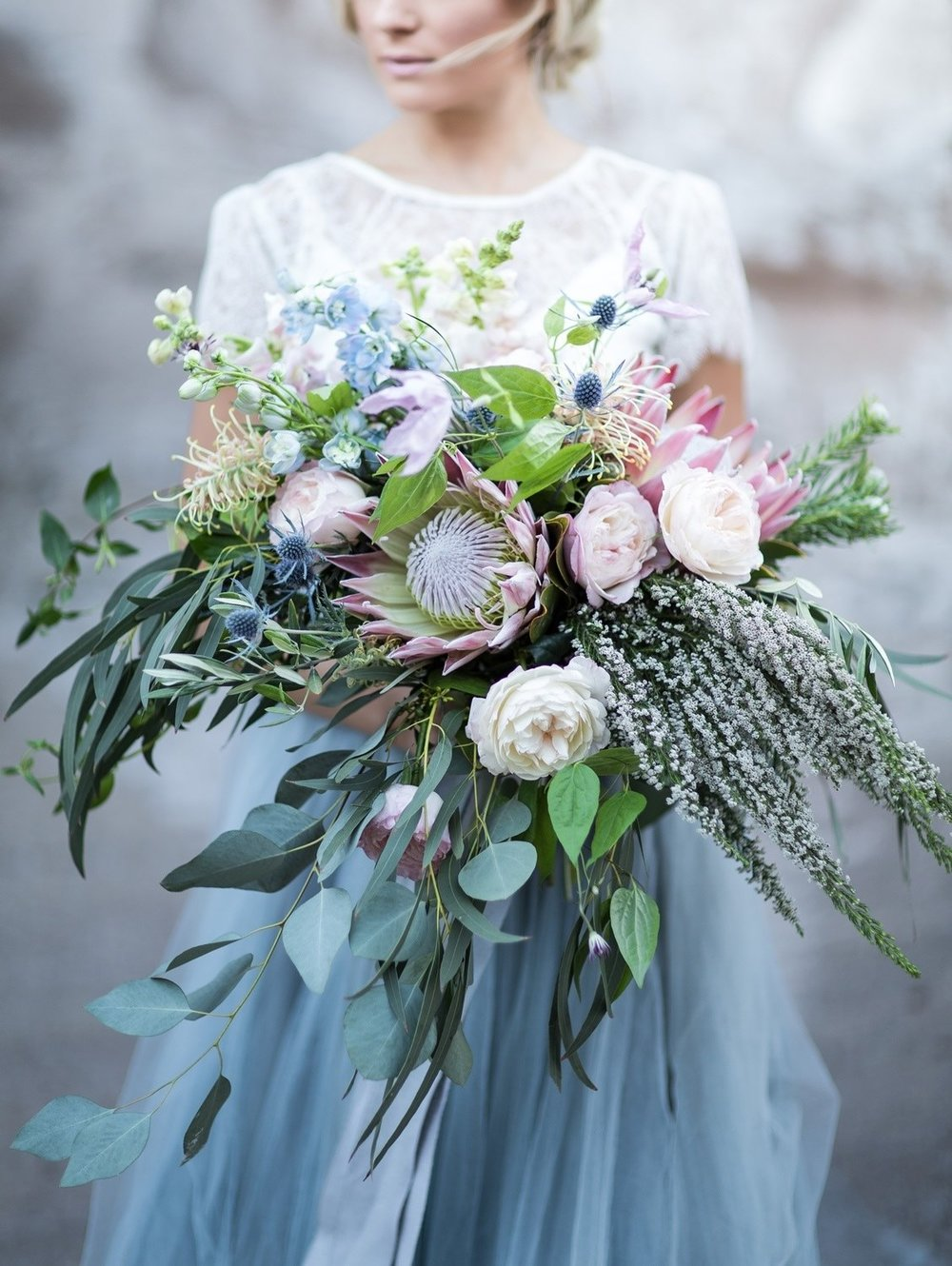 bridal bouquet serenity and rose quartz king protea