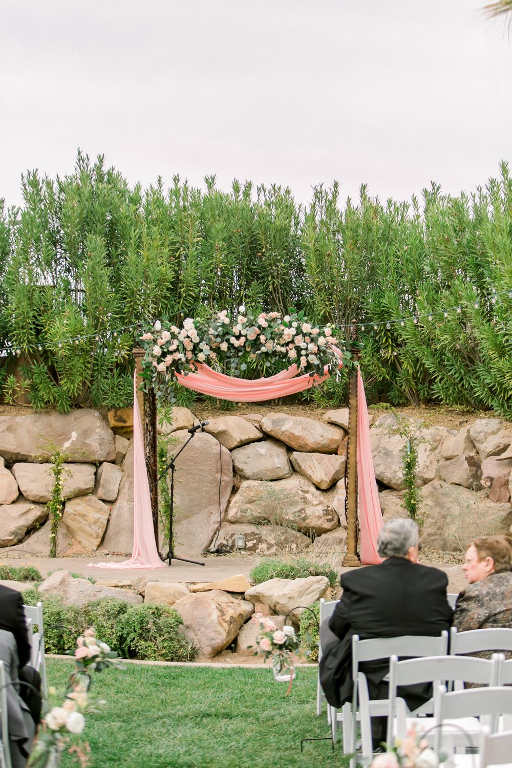 floral arch ceremony backdrop