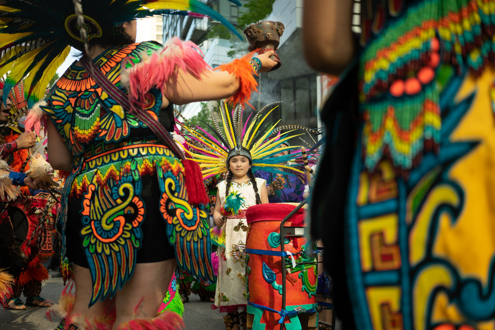 A young member of CeAtl Tonalli, an Aztec dance group leading the 2018 May Day labor march.
