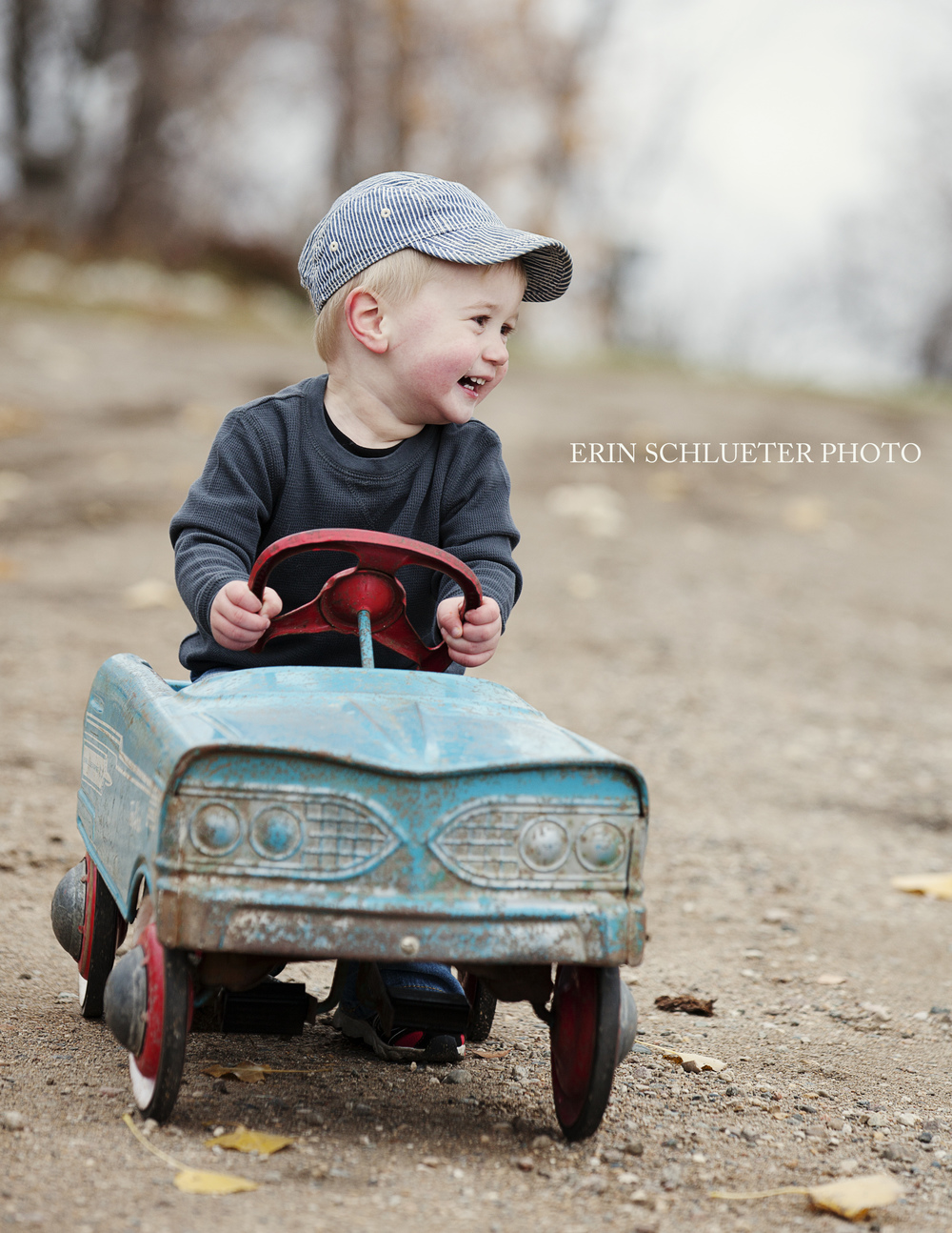 Rylee driving his antique pedal car for his Fall Mini-Session