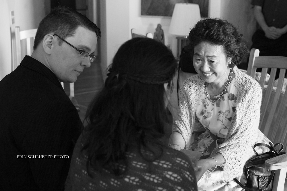 The bride and groom exchange a moment with the Mother of the Bride during a tea ceremony held before the couple exchanged vows.