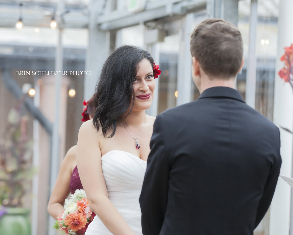 """The lovely bride and groom saying """"I do"""" at the Merrill Commons at the Soest Herbaceous Display Garden."""