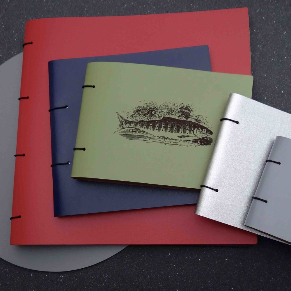 leather notebooks and albums.jpg
