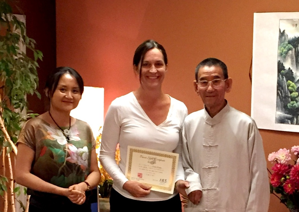 Kristen Hawkes (middle) with Master Weiye Wang (right) and Chiyan on June 27, 2015