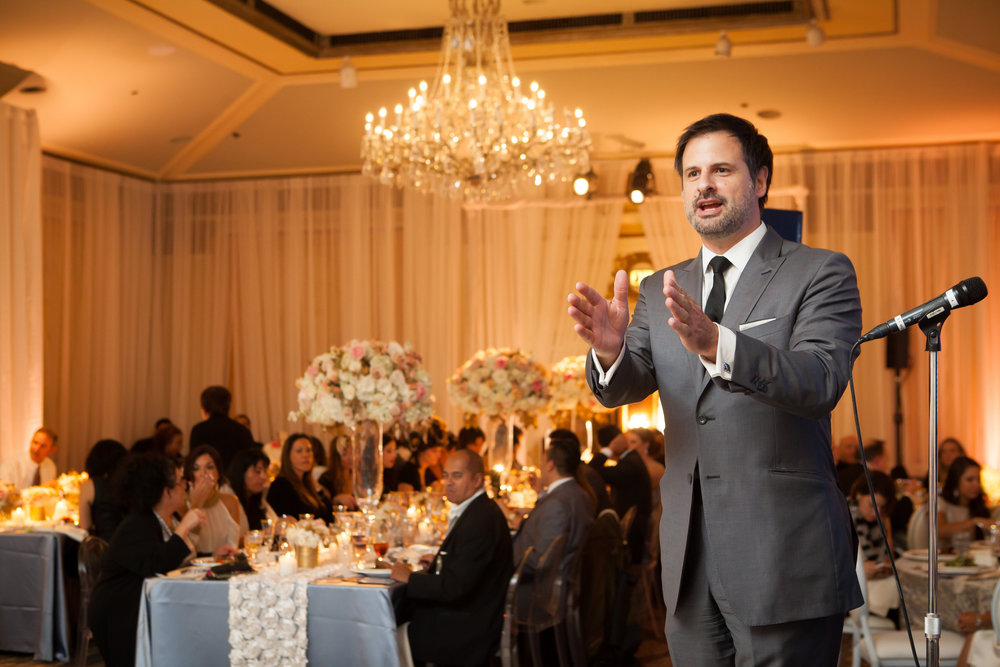Serving as emcee and entertainment at a Gala Event at the Sir Francis Drake Hotel, in San Francisco