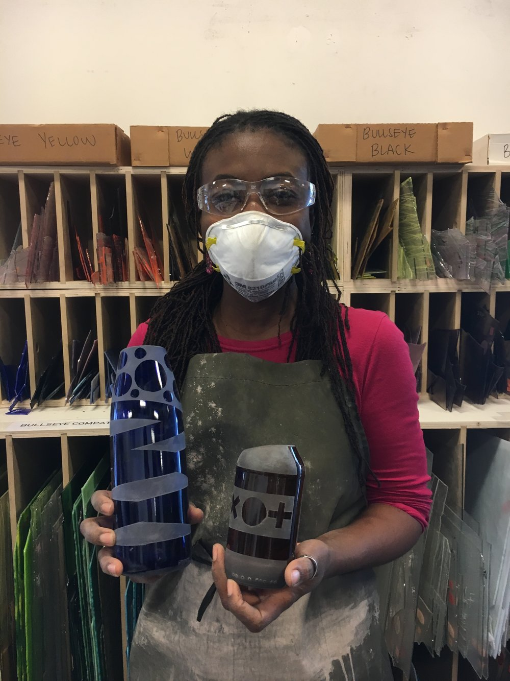 Ama holding bottles / vases
