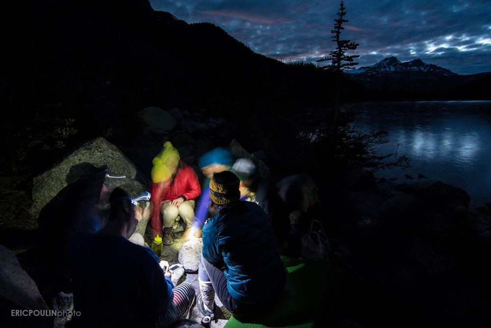 Playing cards by headlamp as the night closes in