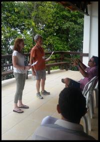 Bumgarner presenting with her translator, Harold Pinto